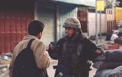Israeli soldier checks Omar's ID in Hebron
